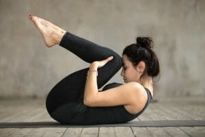 Woman doing yoga representing alternative pain relief achieved after using NeoRelief natural pain relief products