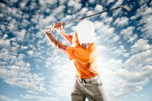 Golfer swinging club with arms and shoulders representing potential for pain-free activity with NeoRelief for pain