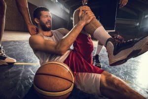 Young basketball player experiencing joint pain